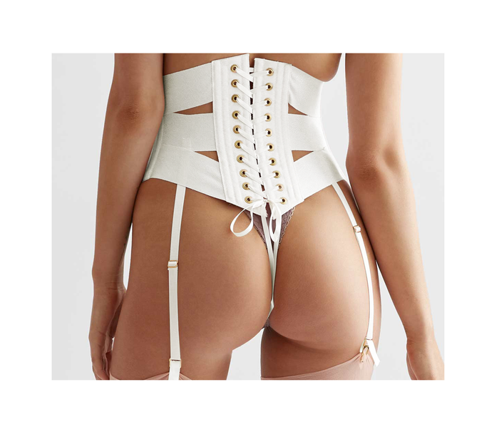Lacing on white ribbon corset, made with panels of ribbon for a vintage inspired silhouette