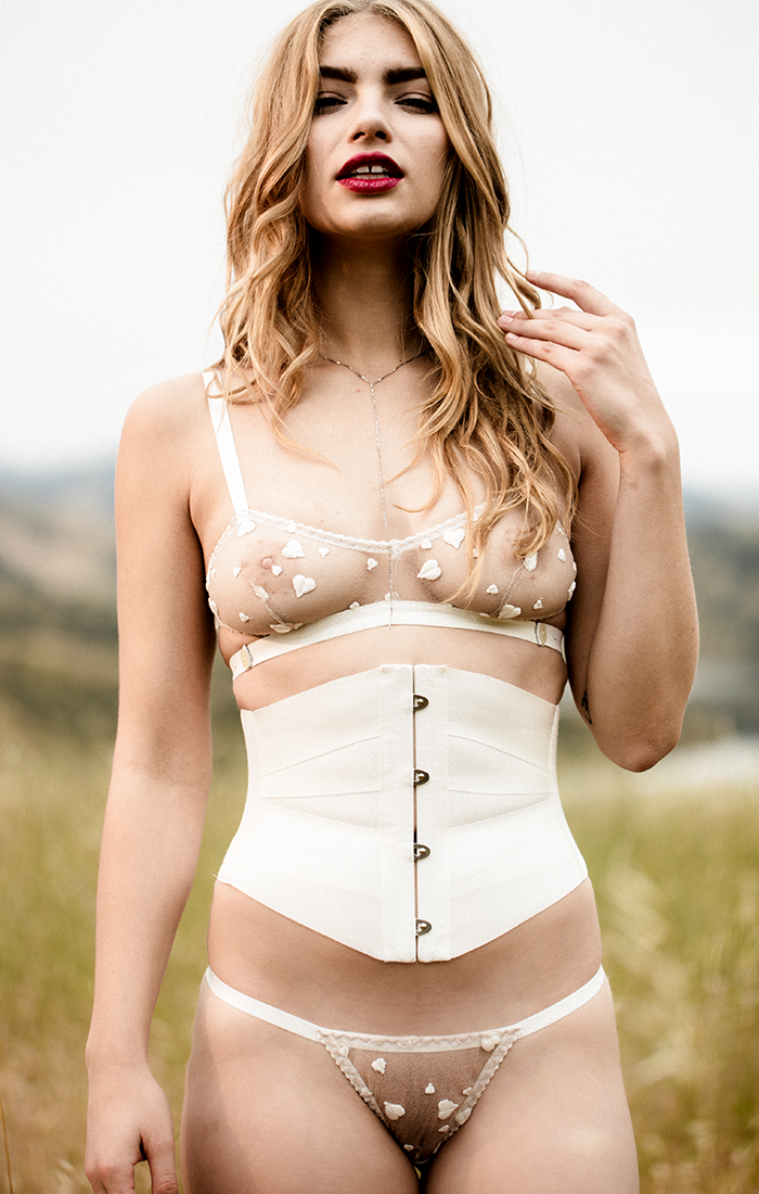 Luxury ivory ribbon corset worn with sheer lace lingerie for vintage inspired glamour