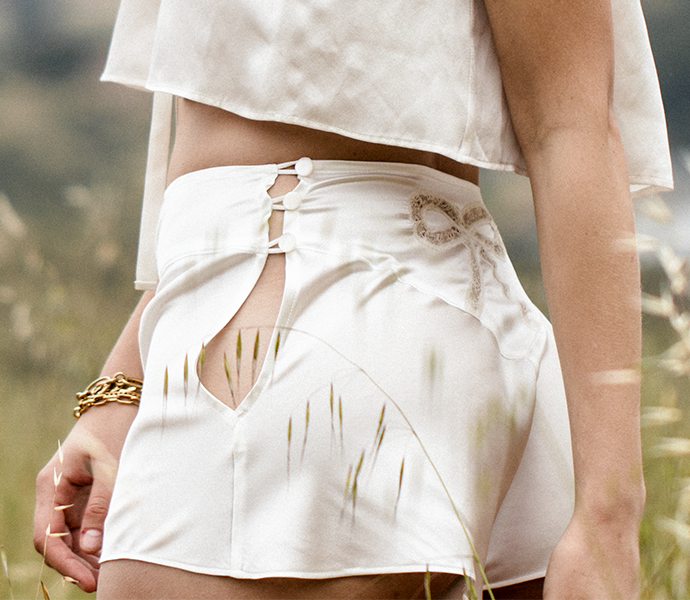 Ivory silk tap pants with matching ivory silk camisole and button fastening detail