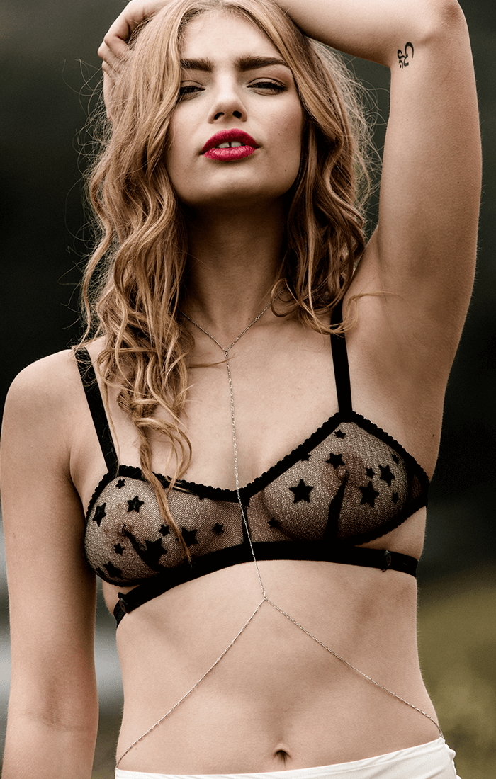 Strappy lace bralette in sheer black star lace with vintage style crossover strap back