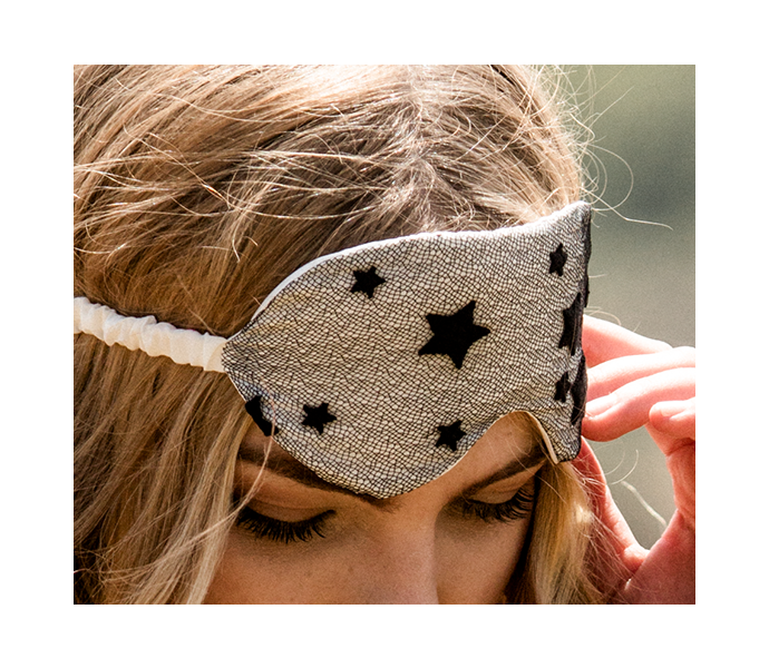 Lace detail on silk eye mask with ivory silk and black star pattern lace