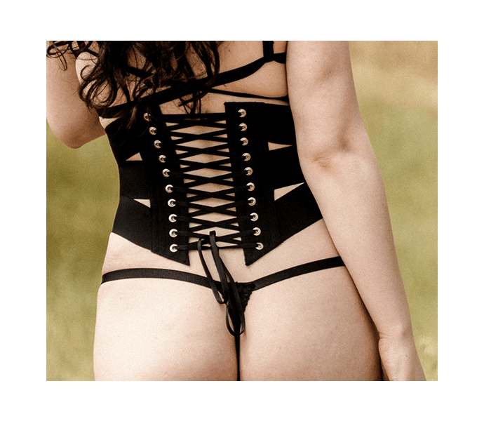 Vintage style ribbon corset worn with black silk thong and strappy back bralette