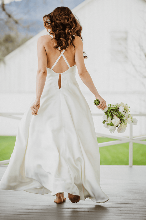 Silk slip wedding dress in bias cut ivory silk with crossover back