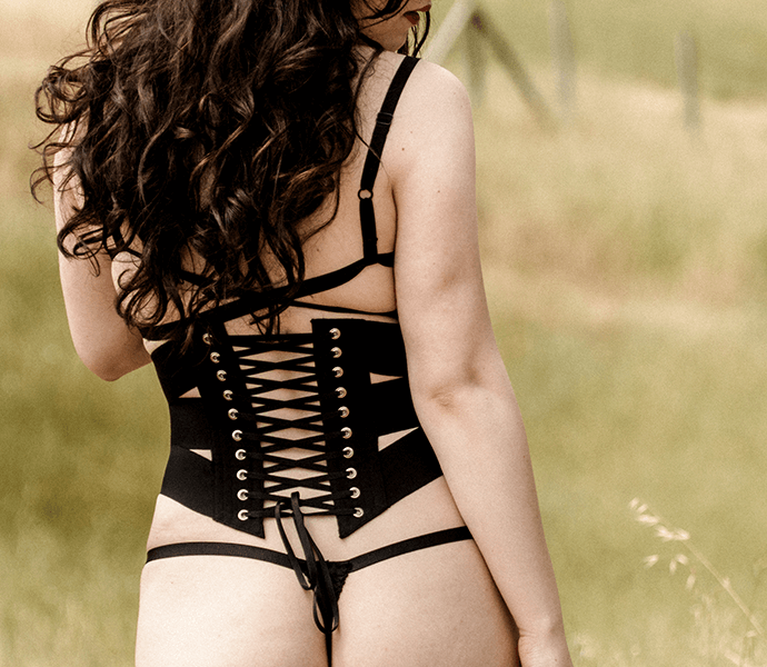 Black ribbon corset back lacing, worn with luxury thong and strappy bralette
