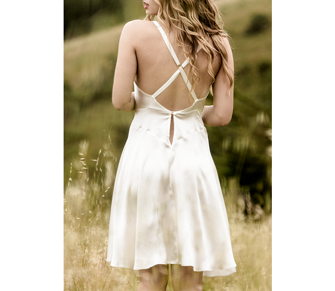 Crossover back straps on ivory silk slip dress with vintage inspired cut in luxury silk charmeuse