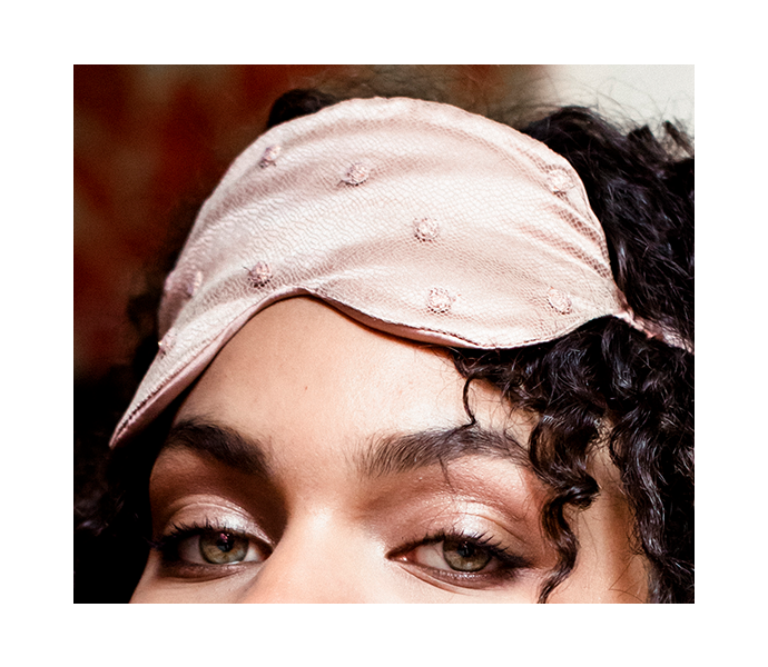 Eye mask detail with fine lace overlay on luxury pink silk