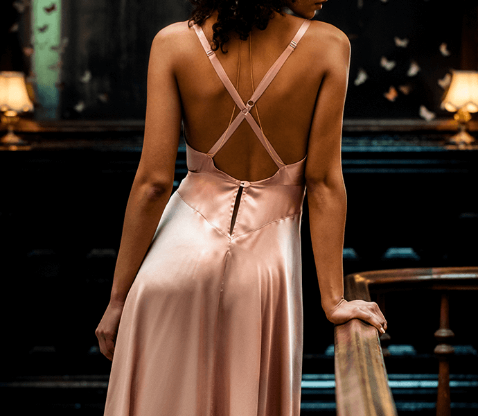Crossover back detail on long silk slip dress in vintage inspired blush pink silk