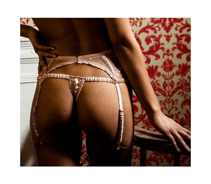 Luxury silk thong worn with sheer pink lace garter belt