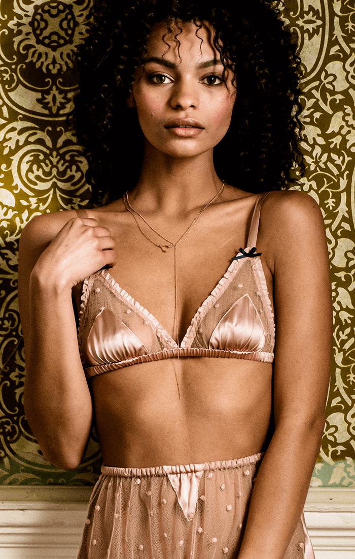 Vintage inspired silk triangle bralette with fine lace trim worn with sheer lace tap shorts