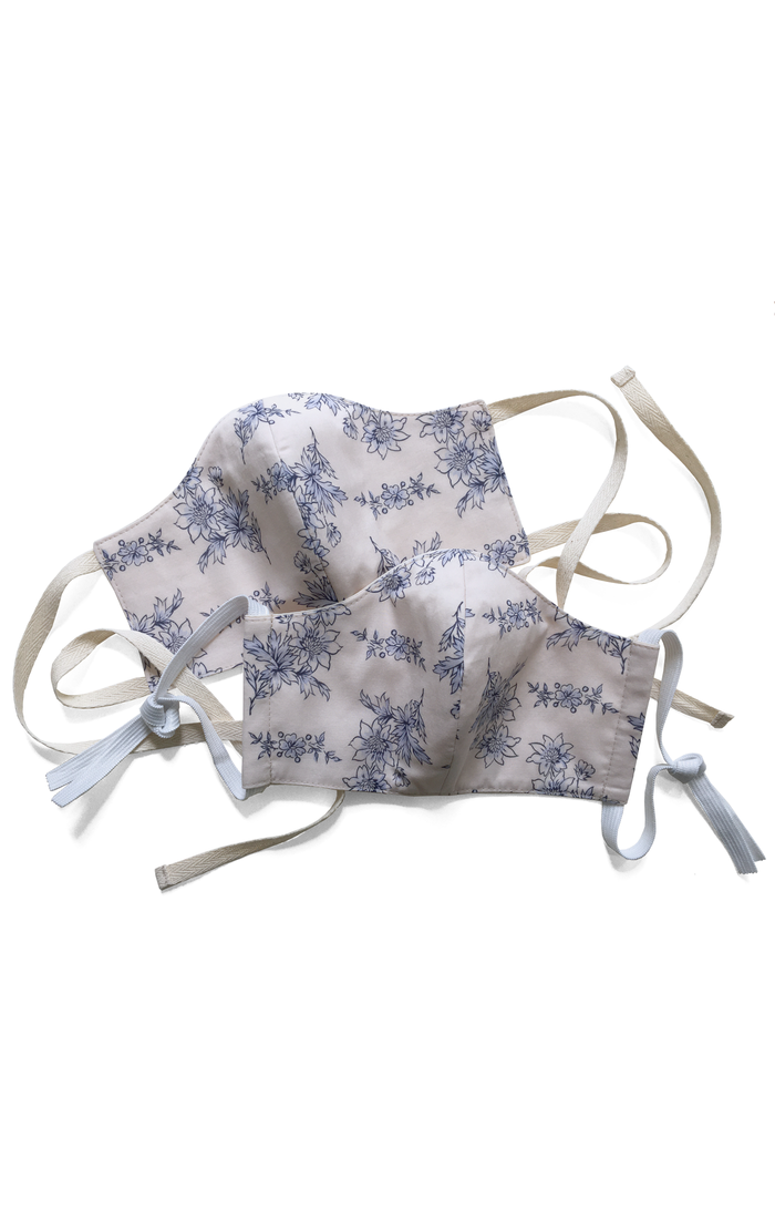 Cotton face mask covering in blue and white printed cotton with elastic or tape fastening