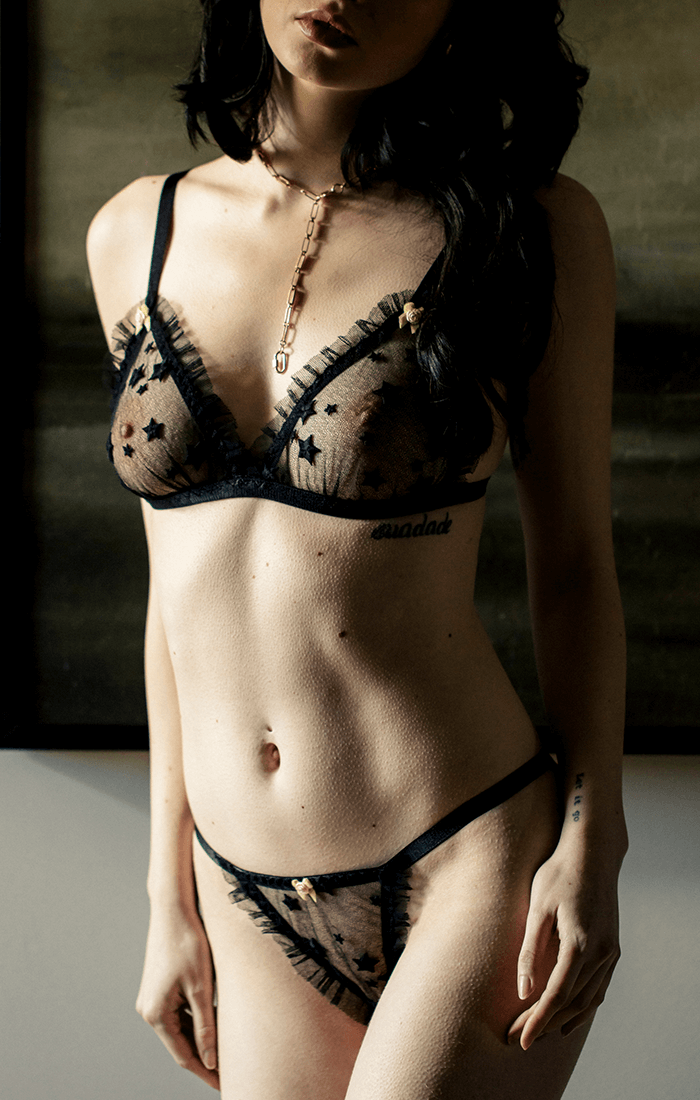 Fine lace vintage inspired lingerie set with delicate ruffles and sheer star embroidery