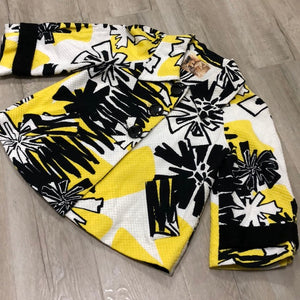 Cute blouse with black & yellow print.
