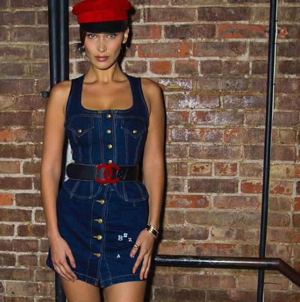 bella hadid wearing a page boy hat
