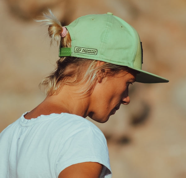 green strapback hat