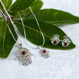 Hamsa Hand Stud Earrings in Silver and Amber