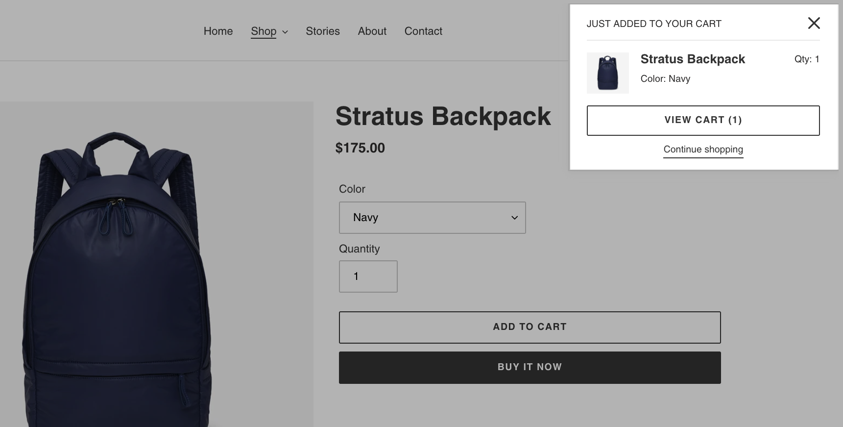 A product page with a popup notification in the top right showing what item was just added to the cart